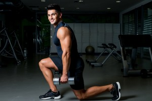 dumbbell-lunge-young-man-exercising-lunges-weights